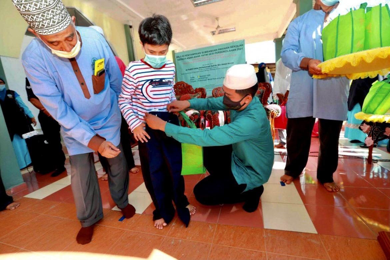 Persatuan Infaqniah Pekan santuni 100 anak yatim